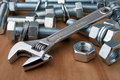 Chrome wrench and bolts Royalty Free Stock Image
