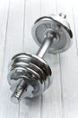 Chromed fitness dumbbell Stock Photo