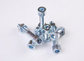 Chromeplated bolts and nuts Royalty Free Stock Photo
