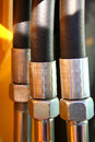 The chromeplated nuts and the reinforced hoses of hydraulic Royalty Free Stock Photo