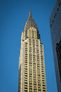 Chrysler building manhattan new york city rising into blue sky Royalty Free Stock Image