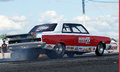 Chrysler drag car napierville dragway august rear side view of making a burnout at john scotti all out event Royalty Free Stock Photography