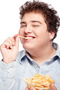 Chubby man and food happy young with french fries in dish isolate on white Stock Images