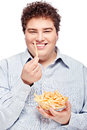 Chubby man and food happy young with french fries in dish isolate on white Royalty Free Stock Image