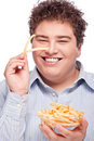 Chubby man with French fries Stock Image