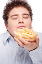 Chubby man with French fries Royalty Free Stock Photography