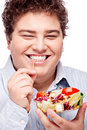 Chubby man with fresh salad Stock Images