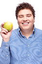Chubby man holding apple happy isolated on white Stock Photography