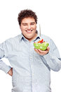 Chubby man and salad happy young with fresh in dish isolate on white Royalty Free Stock Images