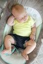 Chubby Newborn Baby Girl Sleeping in Infant Swing Royalty Free Stock Photo