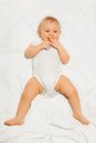 Chubby small baby with fingers near his mouth Royalty Free Stock Photo