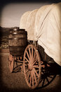 Chuck wagon southwest cowboy with wooden wheels in the desert and a barrel Stock Photo