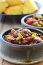 Chuckwagon chili con carne hearty bowls of with beef beans corn tomato and cornbread Royalty Free Stock Image