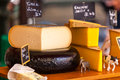 Chunks of different cheeses at a french market Royalty Free Stock Photo