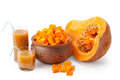 Chunks of pumpkin and pumpkin juice a piece cubes in a clay pot Royalty Free Stock Photos