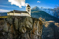 Church above rock view of san martino calonico switzerland Royalty Free Stock Photography