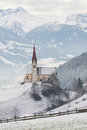Church with an Alpine mountain background in Austria in winter Royalty Free Stock Photo