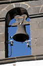 Church bell dark metal ove a blue sky Royalty Free Stock Photos