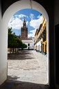 Church bell tower framed by white entrance to road Royalty Free Stock Image
