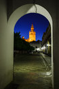 Church bell tower illuminated in arch to street Royalty Free Stock Photo