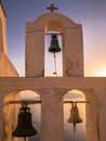 Church Bell Tower at Sunset in Santorini, Greece Royalty Free Stock Photo