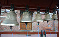 Church bells on a figurative folding belfry Royalty Free Stock Photo