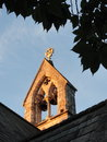 Church bells on stone tower of roof Stock Images