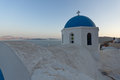 Church with blue roof in town of Oia and panorama to Santorini island, Thira, Greece Royalty Free Stock Photo