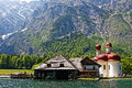 Church and boathouse in alpine lake landscape Royalty Free Stock Photo