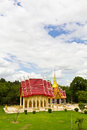 Church and a buddhist pagoda high view of the in the temple of thailand located in the grass near the tree Royalty Free Stock Photography
