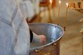 Church candles in closeup hand priest lights hot and burning Royalty Free Stock Photo
