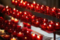 Church candles in red chandeliers Royalty Free Stock Photo