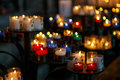 Church candles in red, green, blue and yellow transparent chande Royalty Free Stock Photo