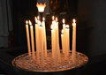 Church candles in a used to pray for the living and the dead photo taken april Stock Photo