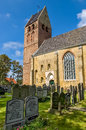 Church and cemetery on hollum island holland old protestant in village the west frisian ameland netherlands Stock Image