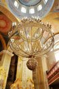 Church chandelier in fresco on the ceiling and a with candles Stock Photos