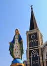 Church of christianity with blessed virgin mary statue Stock Photo