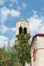 Church clock tower colorful greek with a in the village of pefkohori Royalty Free Stock Photography