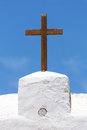 Church cross christian of wood on a white against a blue sky Royalty Free Stock Photo