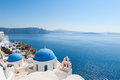 Church domes in oia santorini churches greece overlooking the aegean sea Stock Image