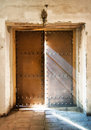 The church door almost close with light rays falling down to the Royalty Free Stock Photo