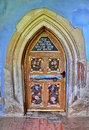 Church door colored wood of an old in a medieval city transylvania romania Royalty Free Stock Photos