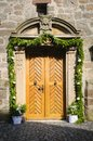 Church door decorated one for a wedding with flowers festively wooden Royalty Free Stock Photography