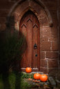 Church door at halloween with ghost wearing top hat Royalty Free Stock Photos