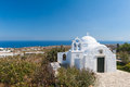 Church in eastern santorini greece surrounded by trees and plants the part of island cyclades the aegean sea is visible the Royalty Free Stock Photo