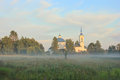 The church in the fog russian novgorod region russian countryside orthodox russian nature sunset field field Royalty Free Stock Photos