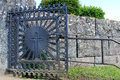 Church gate of wrought iron with a cross old Stock Photos