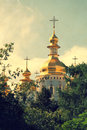 Church with gold domes vintage photo between the trees colors Royalty Free Stock Photos