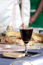 Church interior table in a with all the accessory for a wedding with wine and wafers in focus Stock Photography