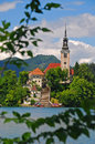 Church on an island at lake bled in the middle of Royalty Free Stock Photo